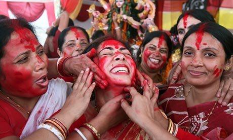 A-Hindu-woman-smeared-wit-010